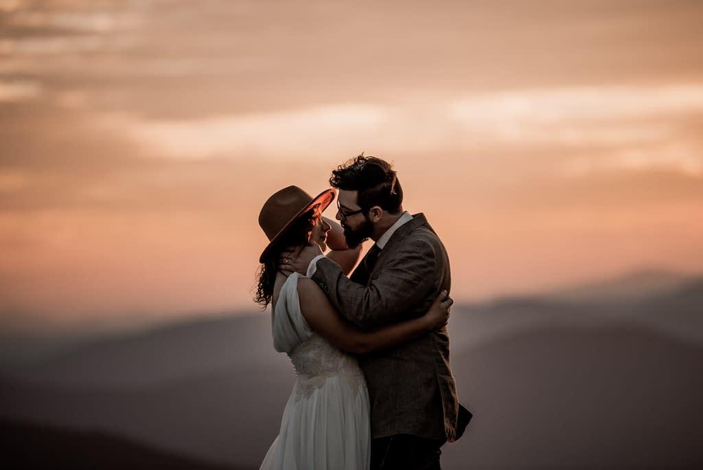 Adventurous elopement photo on a mountain