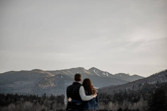 Engagement photos in a field in the Adirondacks