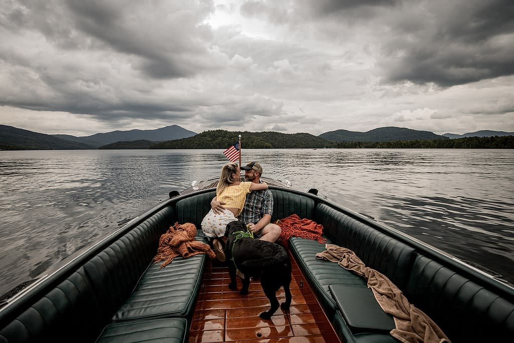 Proposal on a hacker craft boat in Lake Placid, NY in the Adirondacks